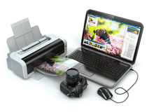 Laptop, photo camera and printer. Preparing images for print. Stock Photography