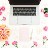 Laptop with pink dairy, roses flowers, marshmallow and accessories on white background. Flat lay. Top view. Freelancer office conc. Laptop with pink dairy, roses stock photos