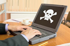 Laptop with pirate software Stock Images