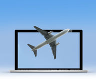 Laptop with plane Stock Photos