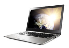 Laptop with planet on screen Royalty Free Stock Photos