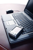 Laptop and Pocket PC Stock Photos