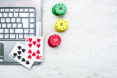 Laptop, poker cards and poker chips Stock Photos