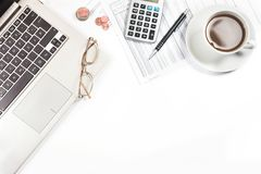 Laptop, printed financial report with number tables, calculator stock images