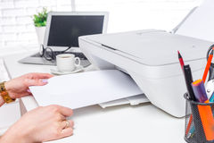 Laptop and printer, office interior Royalty Free Stock Images