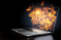 Laptop problem or break. Mixed media. Open laptop with fire flames coming from screen on dark background. Mixed media Stock Image