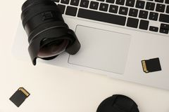 Laptop and professional photographer`s equipment on table. Top view stock photos