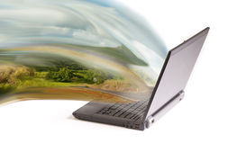 Laptop projecting countryside Royalty Free Stock Photos