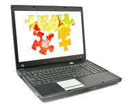 Laptop and puzzle. Stock Images