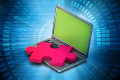 Laptop with puzzle Stock Image