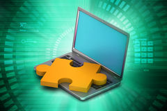 Laptop with puzzle Stock Photography