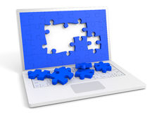 Laptop with puzzle pieces into the screen. Royalty Free Stock Photos