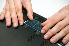 Laptop RAM upgrade. Man installing memory. Laptop RAM upgrade Royalty Free Stock Photography