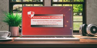 Laptop with ransomware screen on wooden desk at home. Beautiful blurred nature background. 3d illustration. Laptop with ransomware screen and silver color placed Stock Photo
