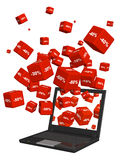 Laptop and red boxes with the goods at a discount Stock Photos