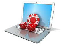 Laptop with red dice and chip. Concept of online gambling Stock Photos