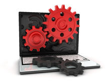 Laptop and red gear Royalty Free Stock Image