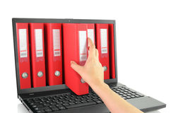 Laptop with red ring binders Stock Images