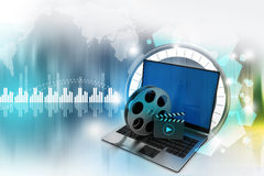 Laptop with reel. In attractive background Royalty Free Stock Photo