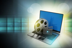 Laptop with reel Royalty Free Stock Photography