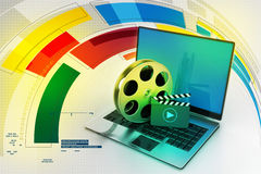 Laptop with reel. In color background Stock Photo