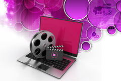 Laptop with reel. In color background Royalty Free Stock Photo
