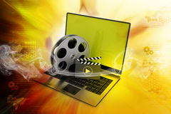 Laptop with reel. In color background Royalty Free Stock Image