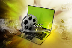 Laptop with reel. In color background Stock Photography