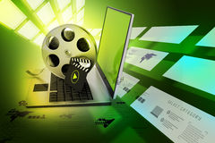 Laptop with reel Royalty Free Stock Photos