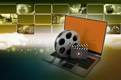 Laptop with reel. In color background Royalty Free Stock Photography