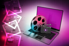 Laptop with reel wheel and clap board Stock Image