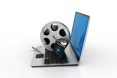 Laptop with reel. In white background Royalty Free Stock Images