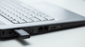 Laptop and removable usb memory Stock Photography