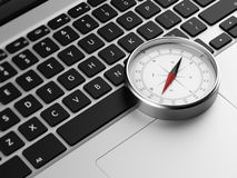 Laptop and retro compass Stock Image