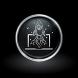 Laptop rocket launch icon inside round silver and black emblem Stock Photo