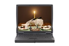 Laptop with romantic dinner invitation on screen Royalty Free Stock Images