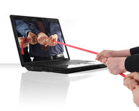 Laptop rope pulling Stock Photo