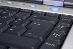 Laptop's keyboard with blue on-button Stock Photo