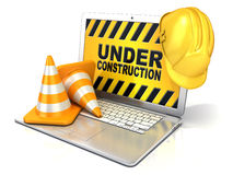 Laptop with safety helmet and traffic cones, concept of computer under construction Royalty Free Stock Images