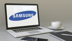 Laptop with Samsung logo on the screen. Modern workplace conceptual editorial 3D rendering Royalty Free Stock Images