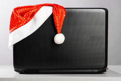 Laptop with santa hat Stock Photos