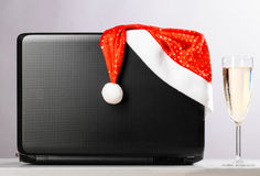 Laptop with santa hat and wine Stock Photos