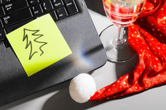 Laptop with santa hat and wine Royalty Free Stock Photos
