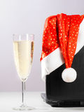 Laptop with santa hat and wine Royalty Free Stock Photography