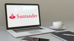 Laptop with Santander Serfin logo on the screen. Modern workplace conceptual editorial 3D rendering Royalty Free Stock Photos