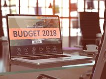 Laptop Screen with Budget 2018 Concept. 3d. Modern Workplace with Laptop showing Landing Page with Budget 2018 Concept. Toned Image with Selective Focus. 3D Stock Photography