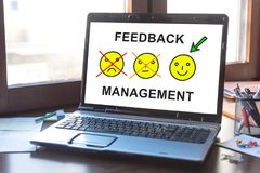 Feedback management concept on a laptop screen. Laptop screen displaying a feedback management concept stock image