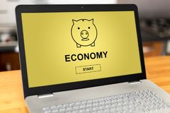 Economy concept on a laptop. Laptop screen with economy concept Stock Image
