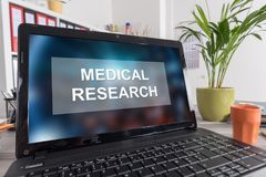 Medical research concept on a laptop. Laptop screen with medical research concept stock image