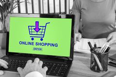 Online shopping concept on a laptop. Laptop screen with online shopping concept royalty free stock photography
